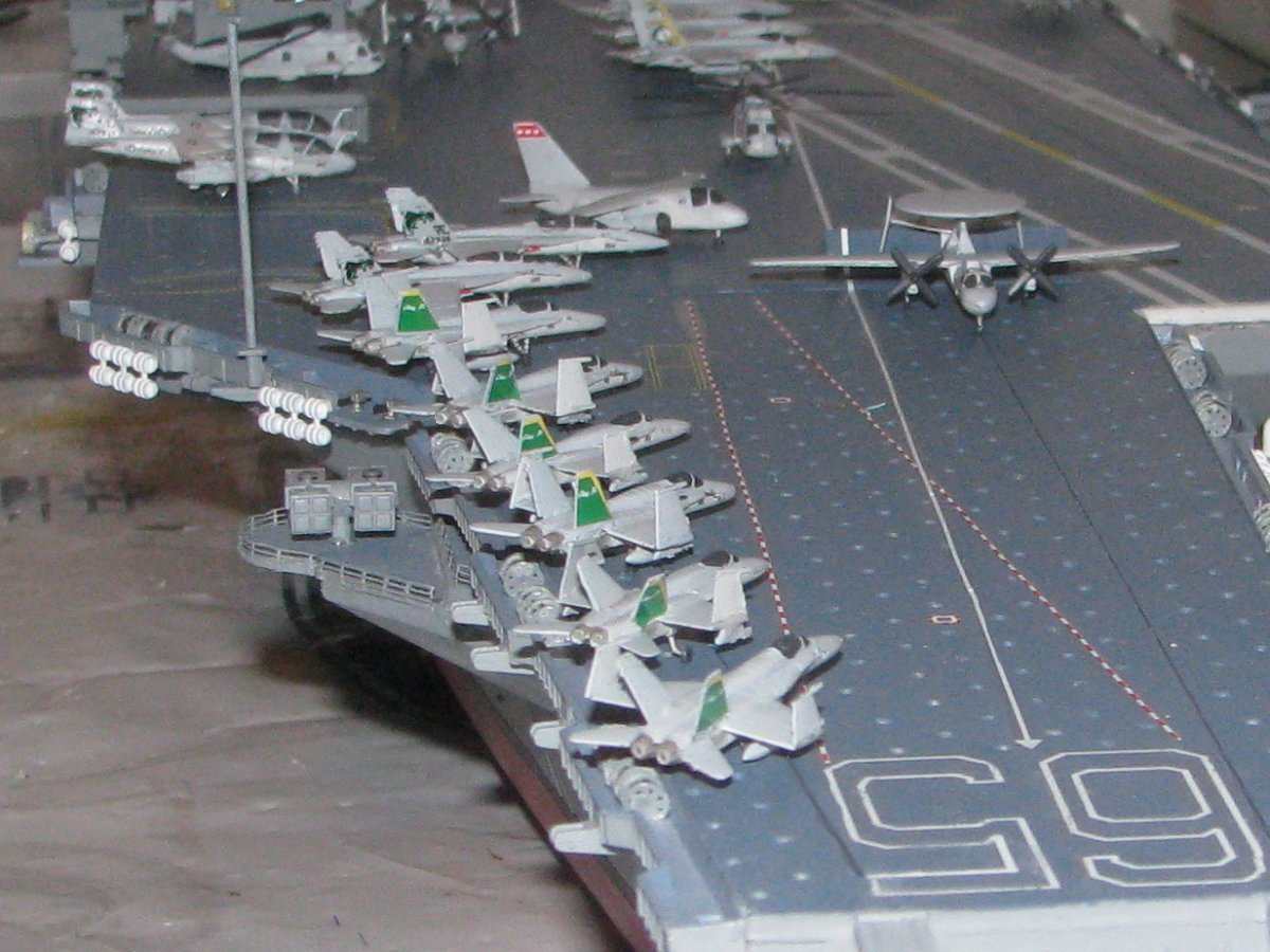 Aircraft carrier models large scale - Eighteen Aircraft Are Being Launched In All With The Other Eighteen On Deck And Spott3ed Around The Deck With Several On The Elevators